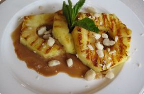 Grilled Pineapple w/ Caramel Sauce & Macadamia Nuts